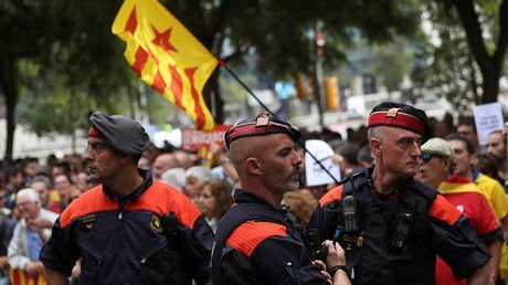 Madrid steps up crackdown on Catalonia referendum, takes control of police