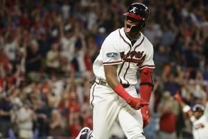 At 20, Braves' Acuna becomes youngest to hit postseason slam