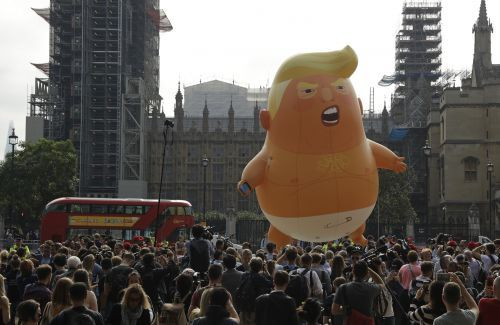Demonstrators mock Donald Trump, protest his visit to UK