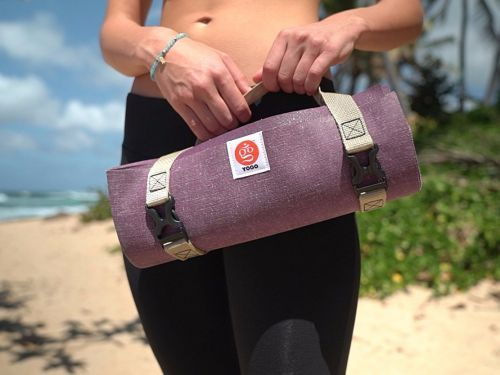 This travel yoga mat only weighs much less than a regular one and folds up to the size of a newspaper