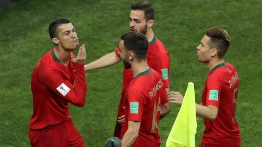 Why did Ronaldo stroke his chin as he celebrated scoring against Spain?