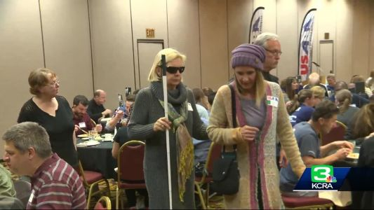 Camp Fire victim a marathon guide for blind, impaired racers