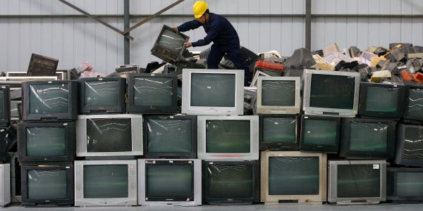 Neighbors were left scratching their heads after pranksters left old TV sets on people's porches overnight - while wearing TVs on their heads