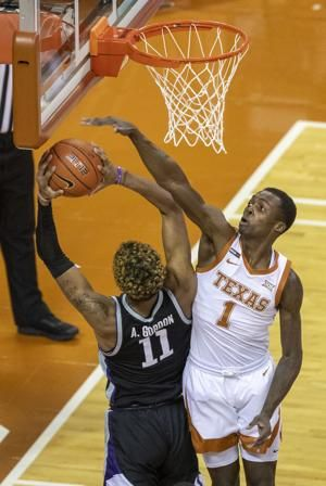 Hepa scores 15 as No. 4 Texas romps over K-State 82-67