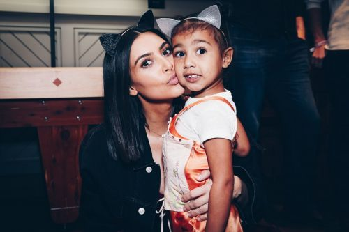 North West was caught covering her face with Kim Kardashian's makeup - and the video is adorable