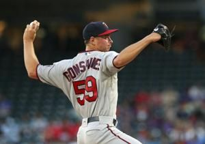 Cave caps 8-run inning with homer; Twins beat Rangers 10-7