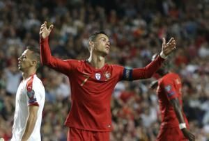 Ronaldo not too worried after leg injury in Portugal draw