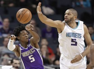 Walker brushes off trade rumors, Hornets top Kings 112-107