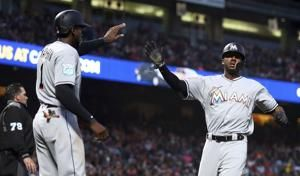 Marlins rally in ninth as Giants squander four-run lead