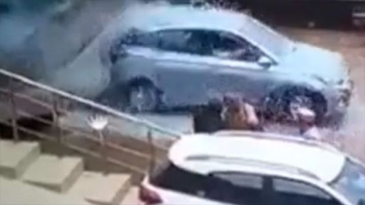 Driver crashes through glass at a dealership while trying new vehicle, video shows