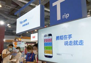 Trip.com shares surge in HK trading debut