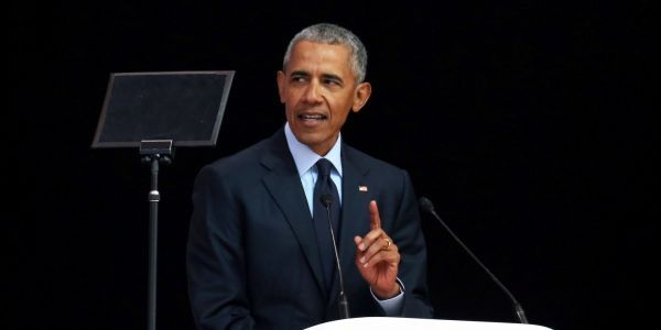 Obama made a rare public appearance to deliver a biting critique of Trump's worldview - without saying his name