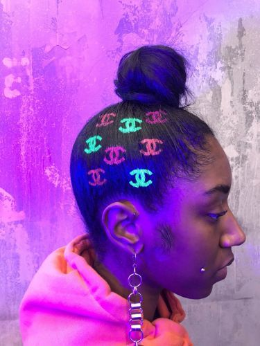 You need to see these UV-glowing neon hair tattoos