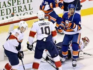 Varlamov stops 27 shots, Isles beat Panthers 2-1 in Game 1