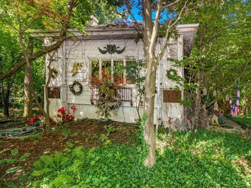 This whimsical cottage in a historic Chicago neighborhood looks like something out of 'The Hobbit' and comes with a 'secret' garden - take a look inside