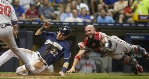 Yelich hits grand slam, Brewers power past Braves 13-1
