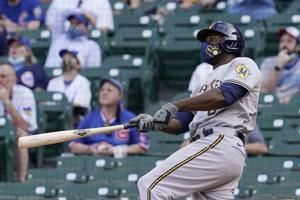 Cain 2 HRs, Woodruff sharp, Brewers beat Cubs 4-2 in 10
