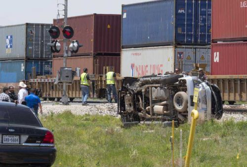 Train collides with deputy's vehicle trying to cross tracks, video shows