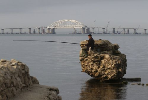 Russia's Putin drives a truck to mark opening of new, illegal bridge to Crimea