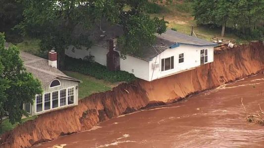 Watch as house in Oklahoma falls into river as floodwaters rise