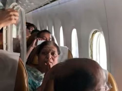 Video shows the terrifying moment a window falls out during a packed Air India flight
