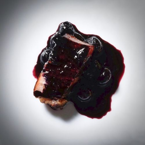 Pork belly with blueberries
