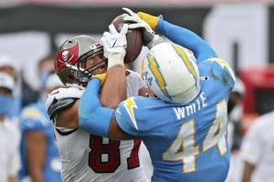 The Latest: Chargers place LB Kyzir White on COVID-19 list