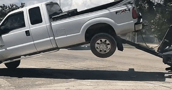 This Epic Ford Super Duty vs. Tow Truck Battle Ended in an Arrest