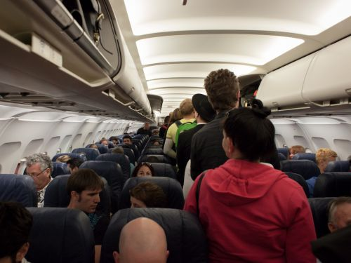 A fight broke out on a plane after a man allegedly refused to stop farting - and now 2 passengers are suing the airline