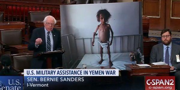 Bernie Sanders stood beside an image of a Yemeni child as the debate on ending US involvement in the Saudi-led war intensifies