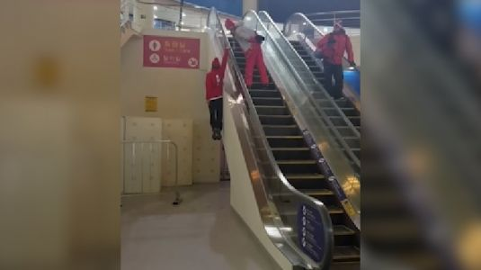 Swiss freestyle skier Fabian Bösch discovers interesting way to use escalator