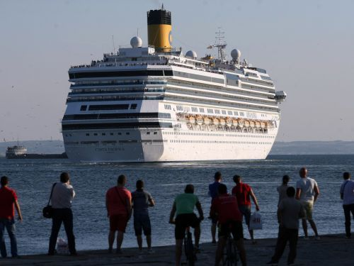 A 75-year-old cruise ship passenger jumped overboard a Carnival-owned ship between Portugal and Spain