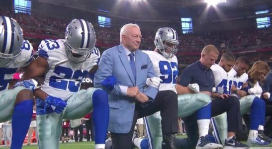 Dallas Cowboys owner, players lock arms and kneel before national anthem