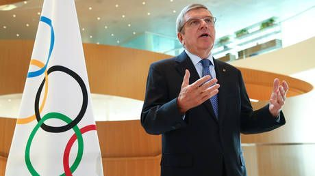 'You can't forever employ 5,000 people': IOC head Thomas Bach admits Tokyo Olympics will be CANCELLED if not held in 2021