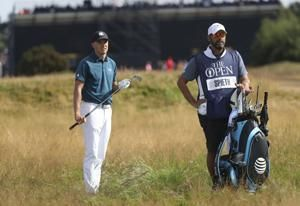 The Latest: Leaders near teeing off in British Open