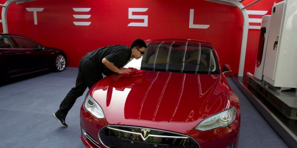 'It would be wrong to exit': Here's why 3 analysts have hiked their price targets for Tesla's stock amid a record-breaking rally