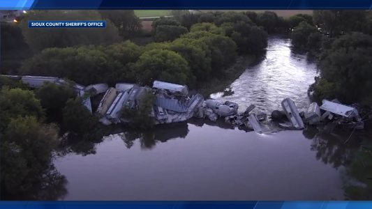 Iowa train derailment plunges rail cars into river