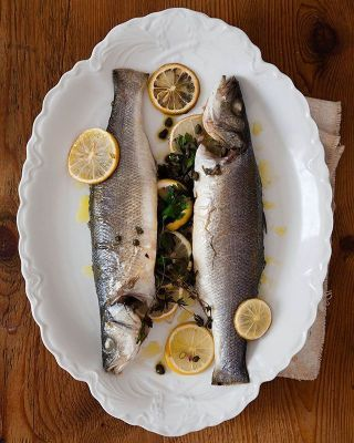Whole Roasted Branzino are the perfect holiday meal for when you're short on prep time but want a wow factor. Link to recipe in bio!