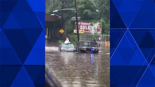 Caught on cam: Police help bride escape quickly rising floodwaters