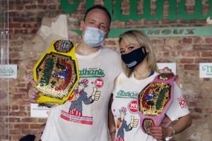 Hot dog champs repeat as July 4 gluttony fest moves indoors