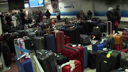 Storm adds to frustrations at Logan on already busy travel day