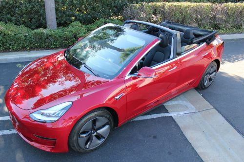 This company will chop the roof off your Tesla Model 3 and make it a power-folding convertible for $39,500 - here's how it's done