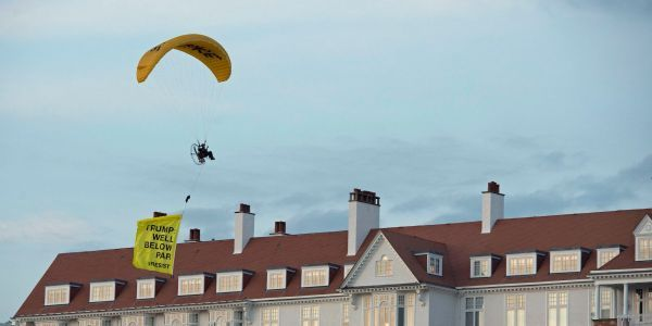 Scottish police are still looking for the protester who paraglided stunningly close Trump, then escaped