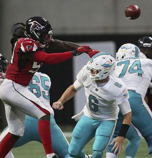 Overcoming adversity, Dolphins rejoin playoff race