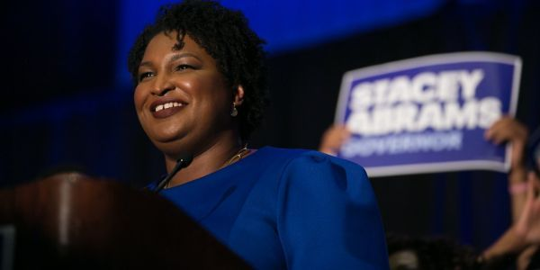 Stacey Abrams, the Oprah-endorsed Democratic candidate, hints at a possible runoff against Republican Brian Kemp in the Georgia governor's race