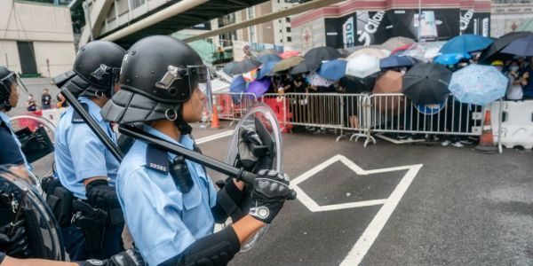 Thousands of protesters crowd the police headquarters in Hong Kong in fresh demonstrations