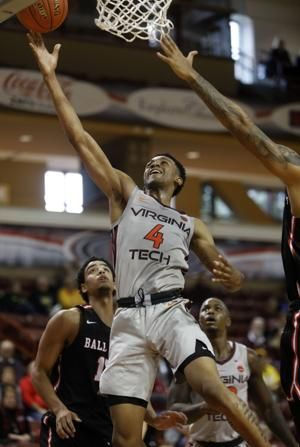 No. 16 Virginia Tech, Northeastern win at Charleston Classic