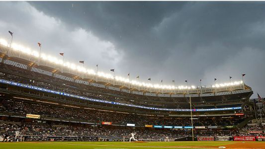 Yankees fans throw a fit - and balls - as team enters cellar; Aaron Boone vents in a better way