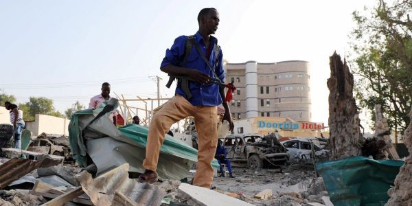 At least 14 people killed in a car bomb blast near a busy hotel in Somalia's capital