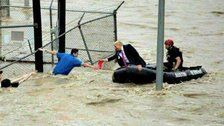 Fake Photo Of Trump 'Rescuing' Flood Victims Goes Viral